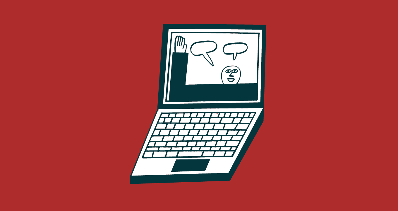 Open laptop with a person on the screen waving hello