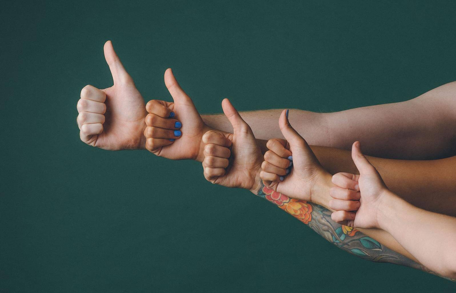 many hands give the thumbs up sign