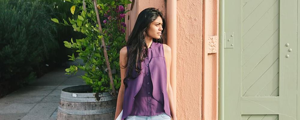 Woman in purple top